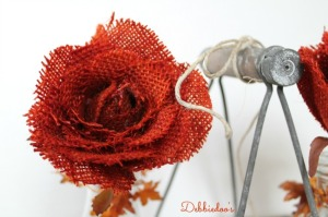 Dipping-burlap-roses-in-tangerine-rit-dye